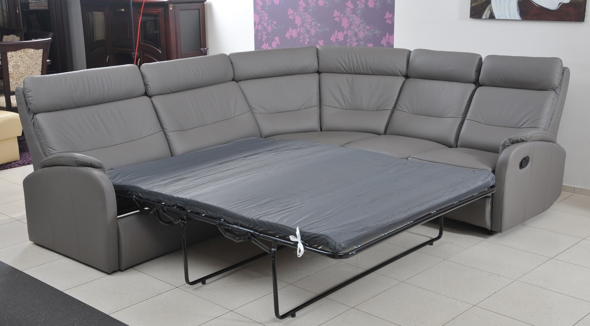 Caro leather corner sofa bed extended